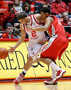 Utah guard Chris Kupets (2) attempts to drive down the court as New Mexico guard Dairese Gary (5) defends during the first half of an NCAA college basketball game, Wednesday, Jan. 19, 2011, in Salt Lake City, Utah. (AP Photo/Colin E Braley)