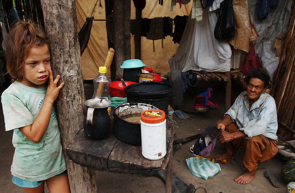 A Colombian girl and her grandmother relax at their home near the border.  There are about 2000 people seeking refugee status in Venezuela, most of whom are Colombians who have fled their country due to increasing violence caused by the conflict in Colombia.  Unable to return to Colombia for fear for their lives, and unable to obtain legal refugee status in Venezuela, many Colombian families live along the border.