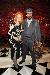 DAME VIVIENNE WESTWOOD and her husband MR ANDREAS KRONTHALER at a party to celebrate the 10th Anniversary of Claridge's Bar, Claridge's Hotel, Brook Street, London on 11th November 2008.