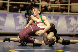 London, Ontario ---2013-03-02---  Shane Johnson of  University Of Sask takes on  Trevor Banks of  Concordia in the men's 54 KG 5th/6th match at the 2012 CIS Wrestling Championships in London, Ontario, March 02, 2013. .GEOFF ROBINS/Mundo Sport Images
