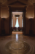 A 28.6 MG FILE FROM FILM OF:..The seal of the Federal Reserve in hall with the Board Room of the Federal Reserve in background. Photo by Dennis Brack
