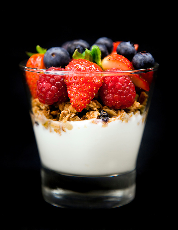 Fruit Parfait in a glass cup on a black background