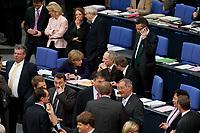 07 MAY 2010, BERLIN/GERMANY:<br /> Angela Merkel (Mi-L), CDU, Bundeskanzlerin, Wolfgang Schaeuble (M), CDU, Bundesfinanzminister, Guido Westerwelle (MI-R), FDP, Bundesaussenminister, waehrend der namentlichen Absimmungen nach der Bundestagsdebatte zur Uebernahme von Gewaehrleistungen zum Erhalt der fuer die Finanzstabilitaet in der Waehrungsunion erforderlichen Zahlungsfaehigkeit der Hellenischen Republik, der sog. Griechenland-Hilfe, Plenum, Deutscher Bundestag<br /> IMAGE: 20100807-01-104<br /> KEYWORDS: Buergschaft, Bürgschaft, Finanzstabilitaetsgesetz, Gespräch, Wolfgang Schäuble