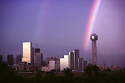 Weather: Rainbow, Dallas, Texas. Rainbows occur when the observer is facing falling rain but with the sun behind them. White light is reflected inside the raindrops and split into its component colors by refraction. (1981)