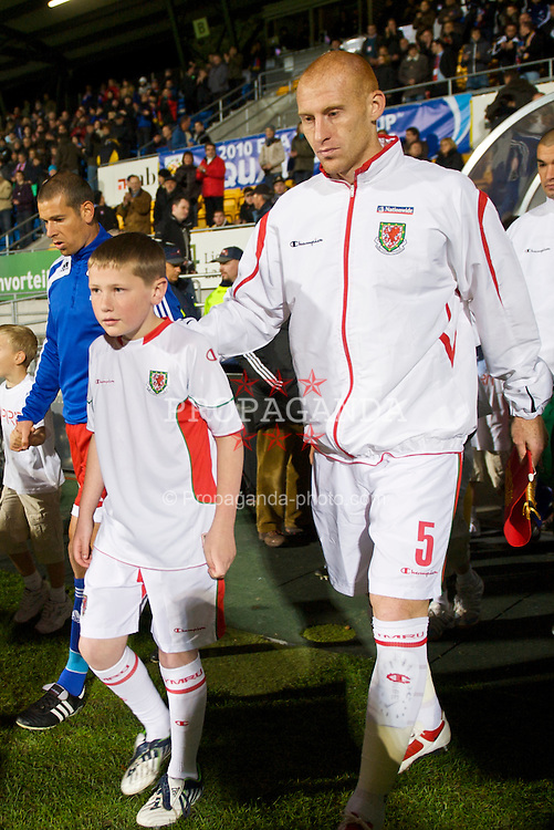 VADUZ, LIECHTENSTEIN - Wednesday, October 14, 2009: Wales' new captain James Collins leads his side out to face Liechtenstein during the 2010 FIFA World Cup Qualifying Group 4 match at the Rheinpark Stadion. (Pic by David Rawcliffe/Propaganda)