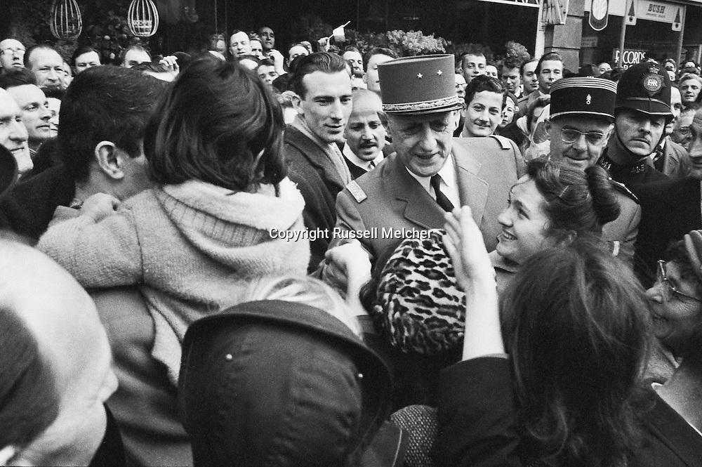 Close up of Charles de Gaulle meeting french citizens in London during his State visit in 1960.<br /> Note for photographers: General de Gaulle was a bit vain and did not wear his glasses in public. His security guard had a formal order to photographers to shake hands with him,whenever offered.I must have done so at least 5 or 6 times during my encounters with the General.<br /> <br /> Gros plan de Charles de Gaulle durant sa rencontre avec les citoyens fran&ccedil;ais &agrave; Londres lors de sa visite d' Etat en 1960 .<br /> Remarque pour les photographes : le g&eacute;n&eacute;ral de Gaulle &eacute;tait un peu vain et ne portait pas ses lunettes en public et ne voulait pas etre photographier avec. Son chef de s&eacute;curit&eacute; avait l'ordre formel aux photographes de lui serrer la main si offert. J'ai du lui serrer la main  au moins 5 ou 6 fois au cours de mes rencontres avec le g&eacute;n&eacute;ral.