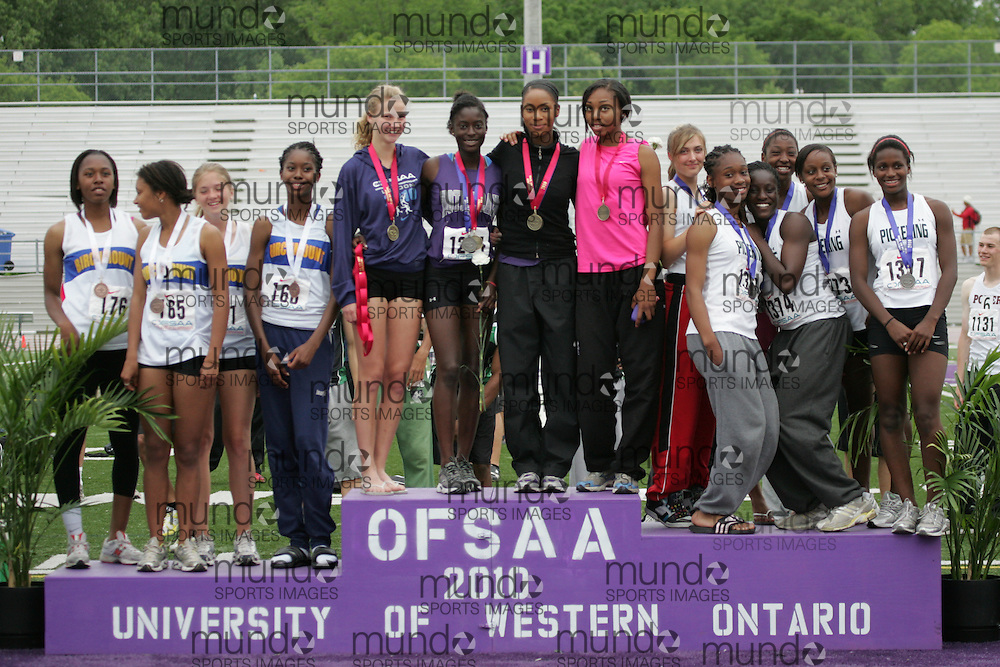 (London, Ontario}---05 June 2010) \Birchmount Park - Scarborough, Notre Dame - Ajax  and Pickering\ receive their medals at the 2010 OFSAA Ontario High School Track and Field Championships in London, Ontario,  June 05, 2010. Photograph copyright Julie Robins / Mundo Sport Images, 2010.