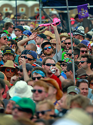 27 April 2014. New Orleans, Louisiana.<br /> Faces in the crowd at Jazzfest. <br /> Photo; Charlie Varley/varleypix.com