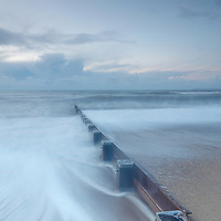 Winter sea view with groynes