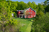 A traditonal red barn and silo at Firefly Farm Firefly Farm, Hauverville, New York, U.S.A.