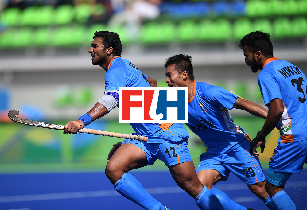 India's Raghunath Vokkaliga (L) celebrates scoring a goal during the men's field hockey Netherland's vs India match of the Rio 2016 Olympics Games at the Olympic Hockey Centre in Rio de Janeiro on August, 11 2016. / AFP / MANAN VATSYAYANA        (Photo credit should read MANAN VATSYAYANA/AFP/Getty Images)