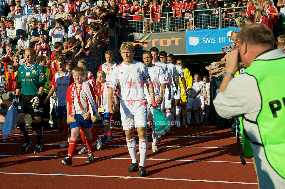 OSLO, NORWAY - Wednesday, August 5, 2009: Liverpool's captain Dirk Kuyt leads his players out before a preseason match against FC Lyn Oslo at the Bislett Stadion. (Pic by David Rawcliffe/Propaganda)