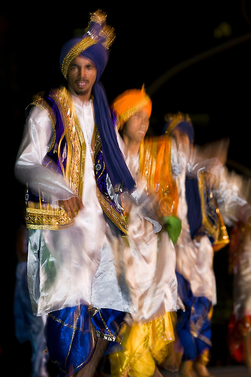 Sikh people perform Bhangra dance during an avent in Putrajaya, Malaysia.<br /> Bhangra is a lively folk music and dance form of the Malaysian Sikh community. Originally a harvest dance, it is now part of many social celebrations such as weddings and New Year festivities. Typically centred around romantic themes with singing and dancing driven by heavy beats of the dhol, a double-barreled drum, the bhangra is engagingly entertaining.