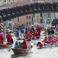 VENICE, ITALY - FEBRUARY 16:  Rowers dresses with  costumes sail under the Accademia Bridge at the traditional regatta on the Grand Canal which officially opens the Venice Carnival on February 16, 2014 in Venice, Italy. The 2014 Carnival of Venice will run from February 15 to March 4 and includes a program of gala dinners, parades, dances, masked balls and music events.  (Photo by Marco Secchi/Getty Images)