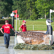 Canadian Team members, Colleen Loach, Clayton Fredericks (coach) Waylon Roberts, Jessica Phoenix and Kathryn Robinson taking a final look at the course at Caledon Equestrian Park Cross-Country Centre during the  Toronto 2015 Pan American Games in Caledon, Ontario, Canada.