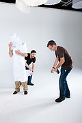 Karl Pilkington (Bald Head, Grey top, wrapped in paper. ), Ricky Gervais ( Black T) With Dan Bragg.