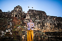 """Viban juggling outside of the temples of Angkor Wat in Siem Reap, Cambodia. Viban is one of the star performers in """"The Adventure"""", a Phare Circus show."""