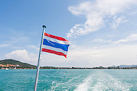 Thailand flag with boat wake at Koh Pha Ngan island