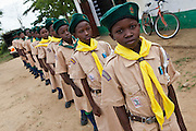 Scouts practice their routine in the grounds of Mari Mani primary school. The Wema Centre has supplied the scouts with all their uniforms, socks and shoes.