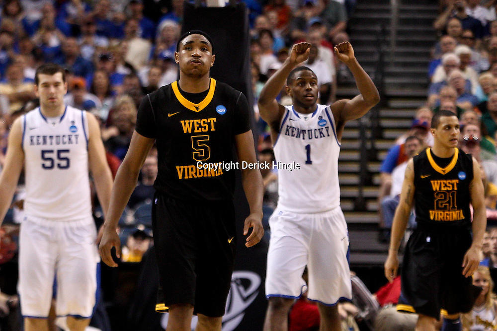 Mar 19, 2011; Tampa, FL, USA; West Virginia Mountaineers forward Kevin Jones (5) reacts after a foul during the second half of the third round of the 2011 NCAA men's basketball tournament against the Kentucky Wildcats at the St. Pete Times Forum. Kentucky defeated West Virginia 71-64.  Mandatory Credit: Derick E. Hingle