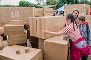 Cardboard boxes are turnetd into bricks with messages on them, to re create the Glastonbury Tor. The project is the idea of a french artist. The Circus Field - The 2016 Glastonbury Festival, Worthy Farm, Glastonbury.