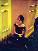 Miserable looking woman in a dress, sitting on the floor, Las Vegas, USA, 2000's