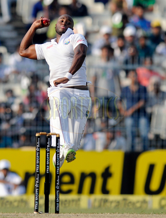 Tino Best of West Indies bowls during day one of the first test match between India and The West Indies held at The Eden Gardens Stadium in Kolkata, India on the 6th November 2013<br /> <br /> Photo by: Pal Pillai - BCCI - SPORTZPICS