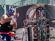 "16 SEPTEMBER 2012 - PHOENIX, AZ:  LIZMARK JR., a Lucha Libre wrestler from Acapulco, Mexico, talks to the crowd before a Lucha Libre mask in front of Chase Field on Hispanic Heritage Day. He is a Lucha Libre ""Rudo"" or villain. The Arizona Diamondbacks hosted their 14th Annual Hispanic Heritage Day, Sunday to kick off Hispanic Heritage Month (Sept. 15-Oct. 15) before the 1:10 p.m. game between the D-backs and San Francisco Giants. The main attraction of the Day was three Lucha Libre USA exhibition wrestling matches in front of Chase Field stadium before the game. PHOTO BY JACK KURTZ"