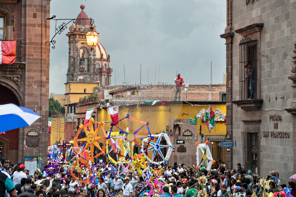 A parade of giant paper mache puppets and decorative stars in a procession through the city at the start of the week long fiesta of the patron saint Saint Michael September 22, 2017 in San Miguel de Allende, Mexico.