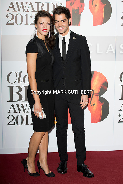 Milos Karadaglic and guest arriving at the 2012 Classic Brit Awards at the Royal Albert Hall in London.