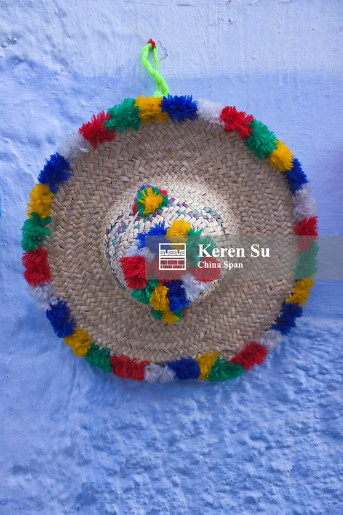 Decorated straw hat on the wall, Chefchaouen, Morocco