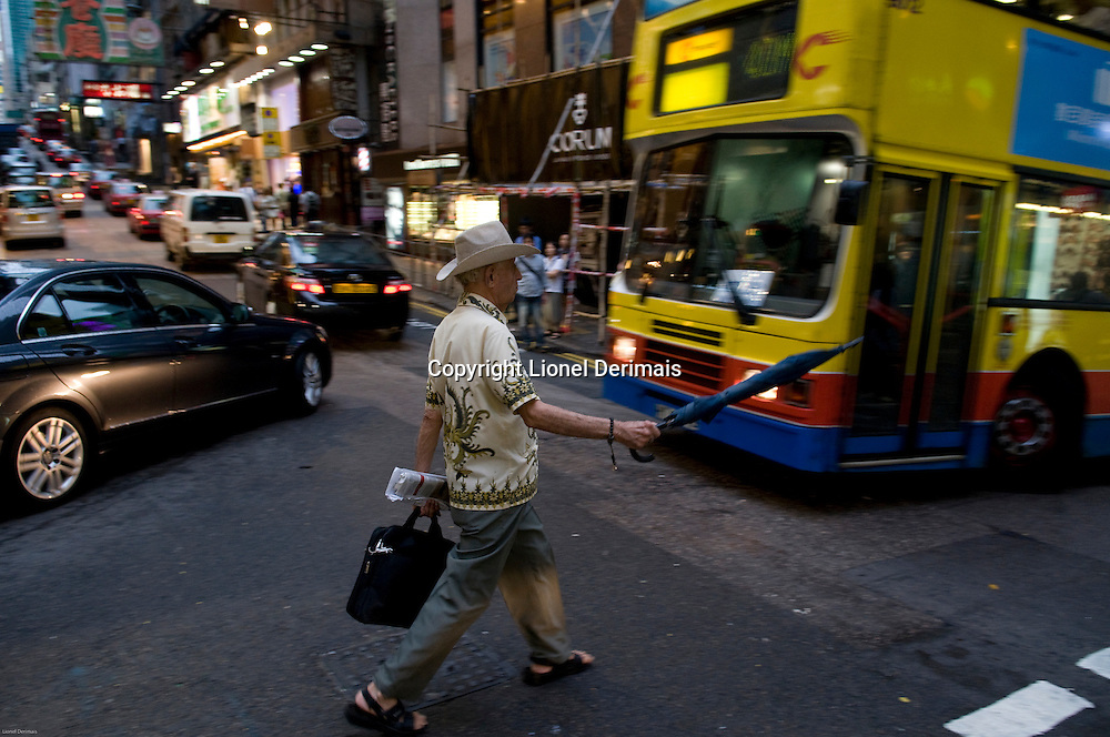 Old man crossing Wellington street, Central, Hong Kong.