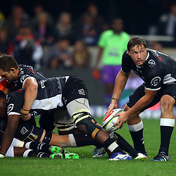 DURBAN, SOUTH AFRICA - JULY 15: Keegan Daniel with Tera Mtembu as Etienne Oosthuizen of the Cell C Sharks gets the ball away during the Super Rugby match between the Cell C Sharks and Sunwolves at Growthpoint Kings Park on July 15, 2016 in Durban, South Africa. (Photo by Steve Haag/Gallo Images)