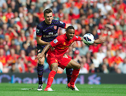 02.09.2012, Anfield, Liverpool, ENG, Premier League, FC Liverpool vs FC Arsenal, 2. Runde, im Bild Liverpool's Raheem Sterling in action against Arsenal during the English Premier League 2nd round match between Liverpool FC and Arsenal FC at Anfield, Liverpool, Great Britain on 2012/09/02. EXPA Pictures © 2012, PhotoCredit: EXPA/ Propagandaphoto/ David Rawcliff..***** ATTENTION - OUT OF ENG, GBR, UK *****