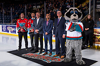 KELOWNA, BC - OCTOBER 03:   Former Kelowna Rockets' players Kelly Guard and Josh Gorges stand on the ice with Memorial Cup Bid Committee Chairman Tom Dyas, Kelowna Mayor Colin Basran, Kelowna Rockets' President and GM Bruce Hamilton and mascot Rocky Raccoon and watch the jumbotron video after the WHL awarded the 2020 Memorial Cup to the City of Kelowna and the Kelowna Rockets at Prospera Place on October 3, 2018 in Kelowna, Canada. (Photo by Marissa Baecker/Getty Images)