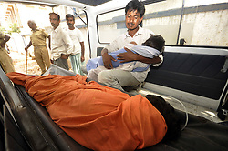 60141100  <br /> A man mourns over his daughter inside an ambulance outside a hospital in eastern Indian state of Bihar, July 16, 2013. At least 21 children, all below 12 years, are now confirmed dead due to food poisoning after eating a free mid-day school meal in the eastern Indian state of Bihar Tuesday, a senior police official said Wednesday, India,<br /> Tuesday, 16th July 2013<br /> Picture by imago / i-Images<br /> UK ONLY