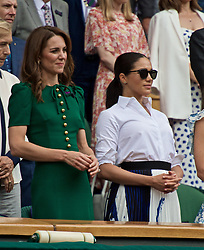 LONDON, ENGLAND - Saturday, July 13, 2019: Catherine Middleton (Duchess of Cambridge) and Rachel Meghan Markle (Duchess of Sussex) applaud from the Royal Box as Simona Halep (ROU) wins the Ladies' Singles final match on Day Twelve of The Championships Wimbledon 2019 at the All England Lawn Tennis and Croquet Club. Halep won 6-2, 6-2. (Pic by Kirsten Holst/Propaganda)