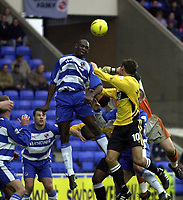 Picture: Henry Browne.<br />Date: 08/11/2003.<br />Reading v Wigan Athletic Nationwide Division One.<br /><br />Shaun Goater rises above Lee McCulloch of Wigan to head clear