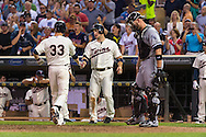 Justin Morneau #33 of the Minnesota Twins is congratulated by Josh Willingham #16 after hitting a home run against the Chicago White Sox on June 19, 2013 at Target Field in Minneapolis, Minnesota.  The Twins defeated the White Sox 7 to 4.  Photo: Ben Krause