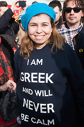 London, February 15th 2015. Londoners demonstrate in solidarity with Greeks in their fight against the EU's insistance that they maintain their programme of austerity. PICTURED: A young woman's sweatshirt sums up her nation's excitable character.