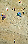 Aerial views of Beach Goers on Coney Island, New York Aerial views of artistic patterns in the earth.