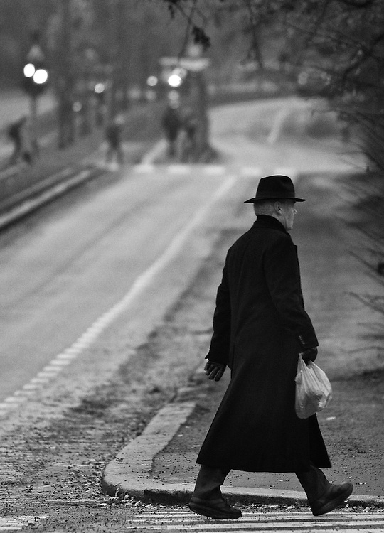 On a grey winter day this black dressed man suddenly appeared like a character from a movie.