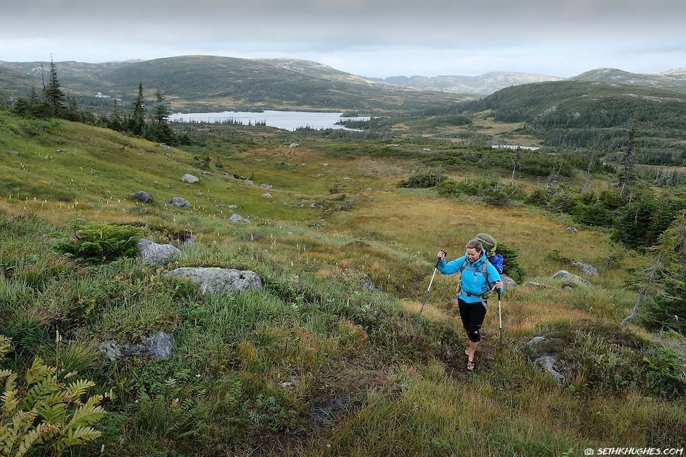 A backpack hiker in Gros Morne National Park, Newfoundland, Canada