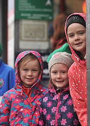Despite the Wet Conditions plenty of competitors and fans joined in to take part in the  Streets of Westport New Year's Day 5km Resolution Run around the town, amoung the supporters were Ruby Sweeney with Amy and Laura Ingham.<br /> Pic Conor McKeown