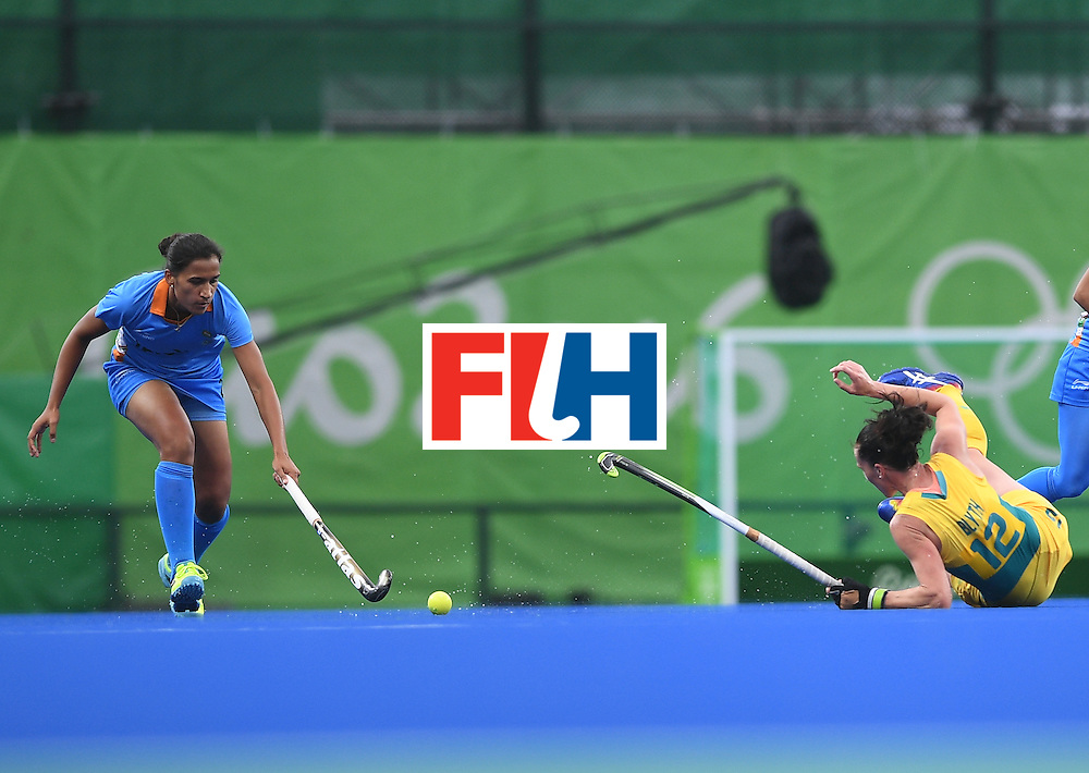 Australia's Madonna Blyth (R) and India's  Rani fight for the ball during the women's field hockey India vs Australia match of the Rio 2016 Olympics Games at the Olympic Hockey Centre in Rio de Janeiro on August, 10 2016. / AFP / MANAN VATSYAYANA        (Photo credit should read MANAN VATSYAYANA/AFP/Getty Images)