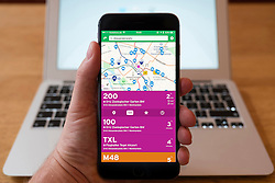 Using iPhone smartphone to display travel route provided by Transit app in Berlin