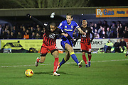 AFC Wimbledon defender Paul Robinson (6) battles for possession with Coventry City forward Kwame Thomas (14) during the EFL Sky Bet League 1 match between AFC Wimbledon and Coventry City at the Cherry Red Records Stadium, Kingston, England on 14 February 2017. Photo by Matthew Redman.