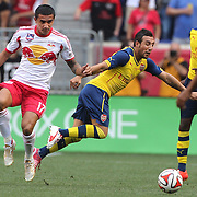 Tim Cahill, (left), New York Red Bulls, challenges Santi Cazorla, Arsenal, during the New York Red Bulls Vs Arsenal FC,  friendly football match for the New York Cup at Red Bull Arena, Harrison, New Jersey. USA. 26h July 2014. Photo Tim Clayton