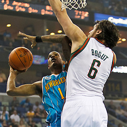 October 27, 2010; New Orleans, LA, USA;  Milwaukee Bucks center Andrew Bogut (6) of Australia defends against New Orleans Hornets small forward Trevor Ariza (1) during the first quarter at the New Orleans Arena. Mandatory Credit: Derick E. Hingle