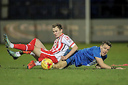 Ryan Hedges (Stevenage) and Carl Magnay (Hartlepool United) fall over having tried to get to the ball during the Sky Bet League 2 match between Hartlepool United and Stevenage at Victoria Park, Hartlepool, England on 9 February 2016. Photo by Mark P Doherty.